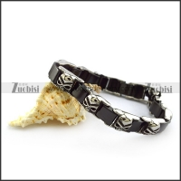 Black Ceramic Bracelet with Stainless Skulls b005607